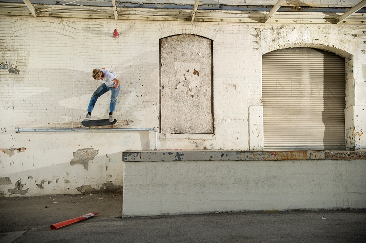 johan-stuckey-kickflip-5050-loading-dock-rail-chinatown-photo-brent-odonnell-speedway-skateboarding-magazine-interview